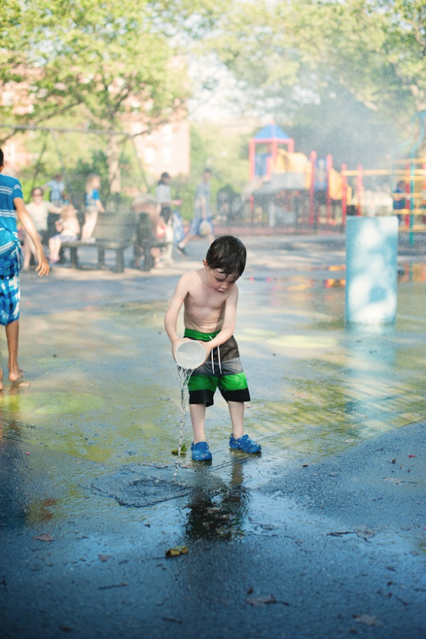 first day playground sprinklers pouring water