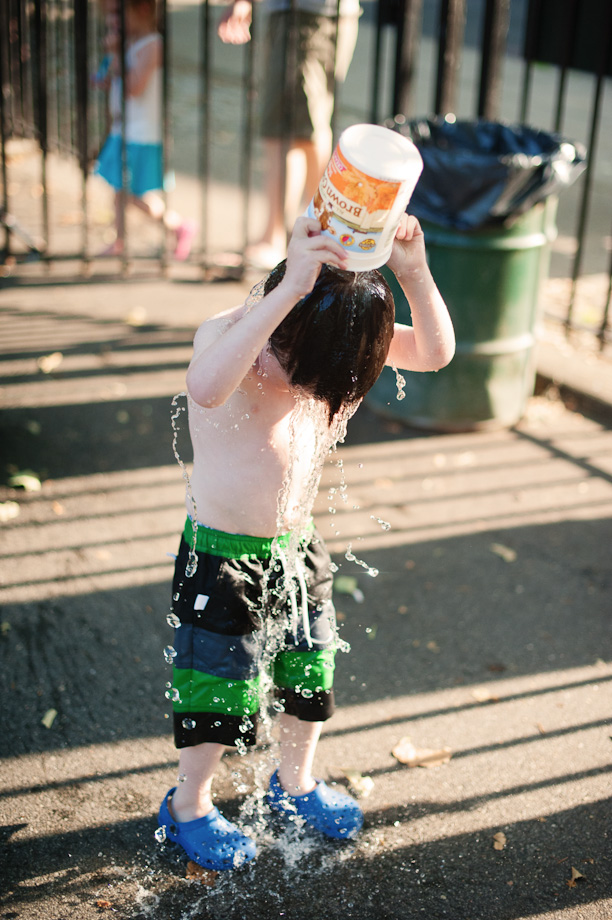 yogurt bucket of playground sprinkler water