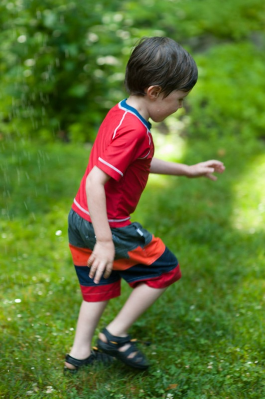 running through sprinkler, green grass
