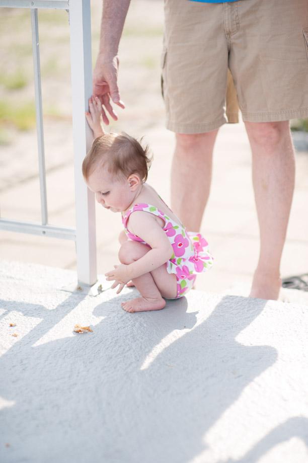 holding baby's hand beach